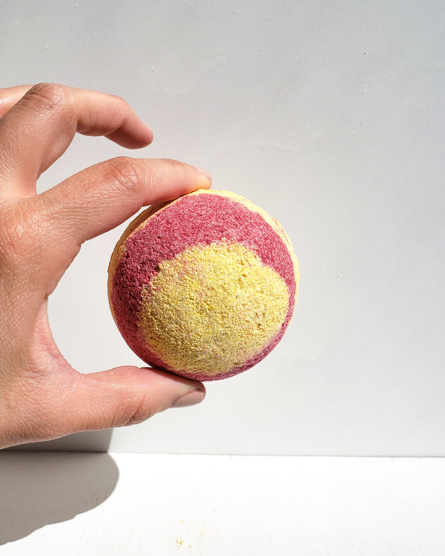 [Highest Quality CBD Skincare & Bath Products Online] - CBD bath bomb, yellow and pink CBD bath product, 100mg full spectrum hemp oil, Lavender, Lemon and Orange scent.