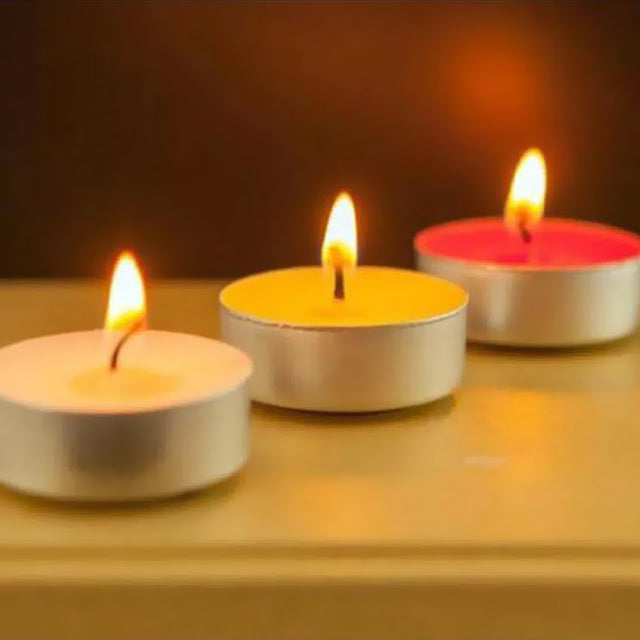 Arooma Decorative Candles Each Pack (Random Colors) | 24hours.pk