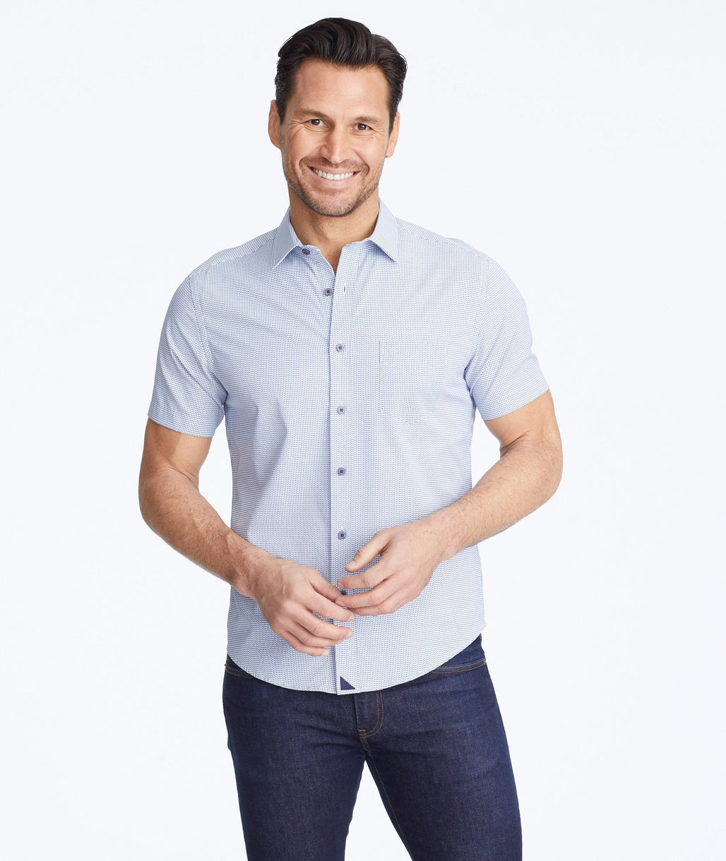 Model wearing a Navy Wrinkle-Free Performance Short-Sleeve Tiefenbrunner Shirt