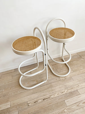 Pair of Vintage White Bent Metal and Cane Bar Stools