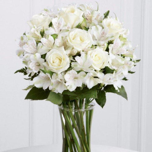 Beautiful white roses and alstroemeria are accented beautifully arranged and hand tied to create an elegant gift that is ready to display straight away. Toronto Online Flower Delivery Service for Luxury Roses providing free delivery in the greater Toronto area for Birthdays, Anniversary, New baby, Weddings, Mother's Day and Valentines day