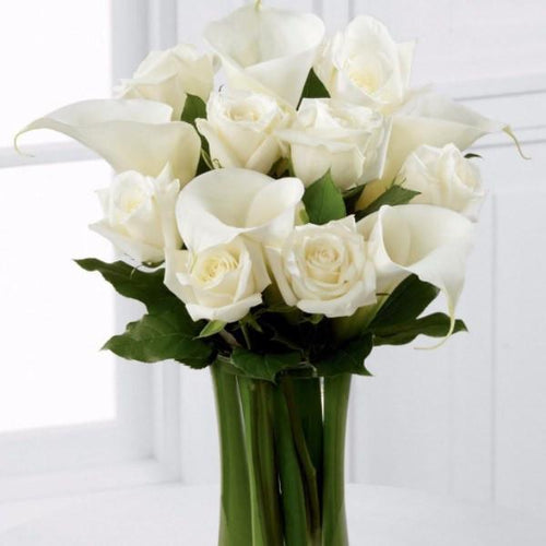 White Rose and White Calla Lily - Beautiful white roses and calla lilies are simply set amongst lush greens and hand tied to create a meaningful gift. Toronto Online Flower Delivery Service for Luxury Roses providing free delivery in the greater Toronto area for Birthdays, Anniversary, New baby, Weddings, Mother's Day and Valentines day