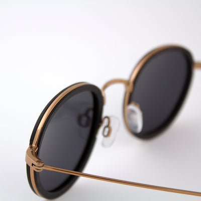 Pasco rose gold lightweight titanium & ebony rimmed wood sunglasses up close