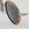 Pasco silver lightweight titanium and rosewood rimmed sunglasses up close
