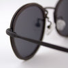 Richey black lightweight titanium & ebony wood sunglasses up close