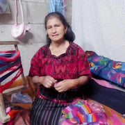 artisan with crochet coin purse guatemala