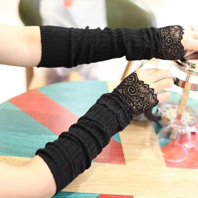 Stretch Knit Arm Warmers With Lace Frill (Elbow) - Elbow-length black knit arm warmers with lace around the wrist.