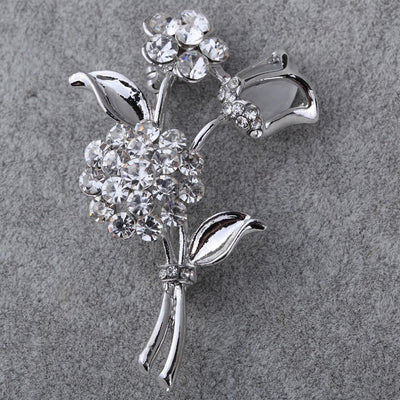 The Bouquet Brooch - A large silver coloured flower brooch.