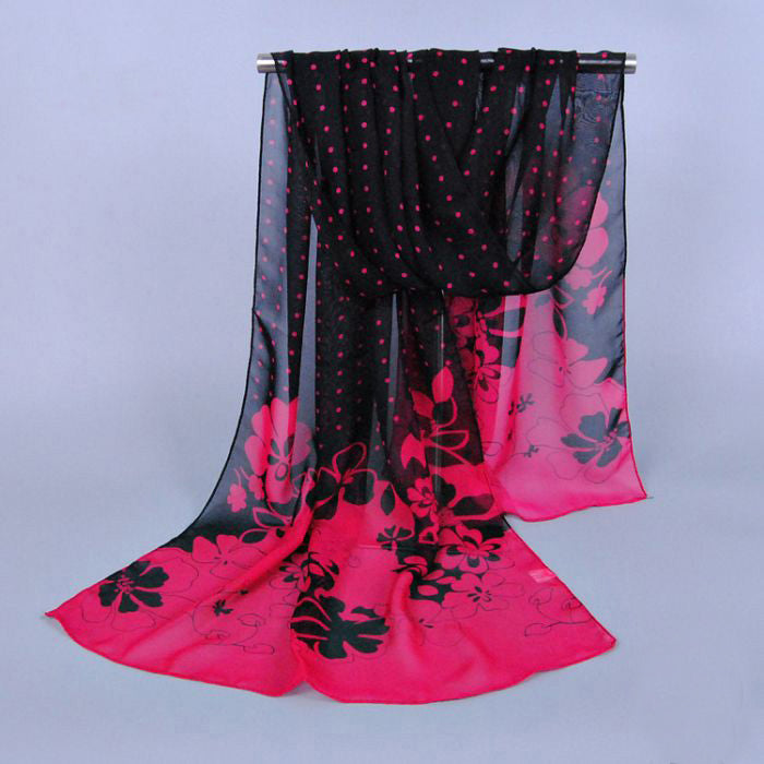 A lovely black and pink polkadot and flower scarf.