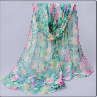 Beautiful chiffon scarves with floral designs in a variety of vibrant colours.
