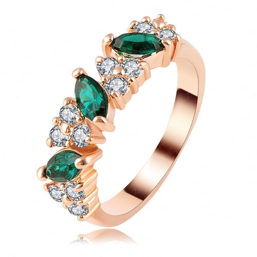 Verdant Cocktail Ring - A lovely rose gold ring with green and white stones.