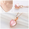 Moonrocy Aphrodite Necklace - A lovely heart-shaped pendant with pink opals and crystals.