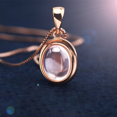 The Penelope Necklace - A lovely delicate pink opal pendant studded with crystals.