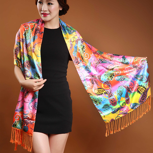A beautiful luxurious silk and cashmere shawl in a vibrant rainbow-coloured paisley print.