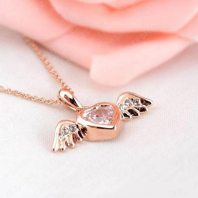 The Be Free Necklace - An adorable gold and crystal pendant of a tiny heart with wings.