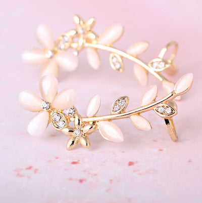A lovely clip-on ear cuff with a floral theme.