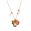 The Pretty Posy Enamel Necklace - A delicate floral pendant in an unusual shade of orange.