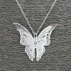 The Vanessa Necklace - A simple silver butterfly, intricately detailed in a lace-like style.