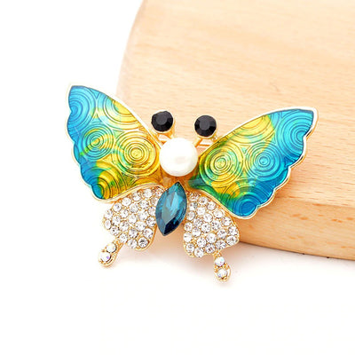 Cute Critters Brooch - Moth - An adorable moth-themed brooch, available in blue or red.