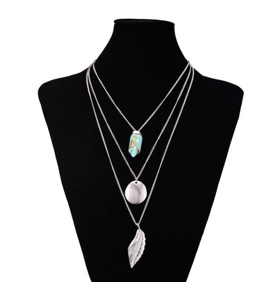 Triple Charm Necklace Set - A multi-layered necklace available in two gorgeous colours.