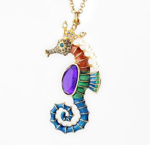 The Poseidon's Steed Sweater Chain - A lovely long necklace with a rainbow coloured seahorse charm.