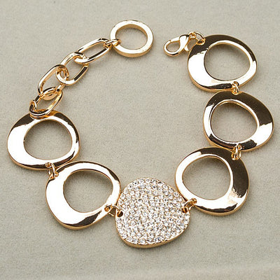 Reuleaux Link Bracelet - An unusual and elegant gold bracelet with large asymmetrical shapes and artificial crystals.