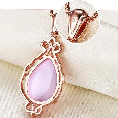 The Merope Necklace - A lovely delicate pink opal pendant studded with crystals.