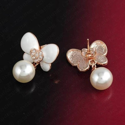 Flutterdrop Earrings - Small stud earrings with a butterfly and pearl motif.