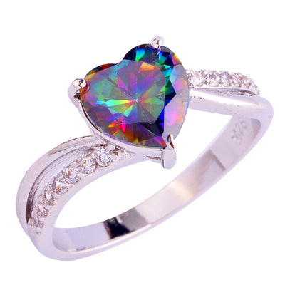 The Lover's Heart Ring - A simple silver band with a rainbow topaz heart and small clear crystals.
