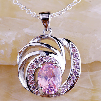 The Hypnotic Coil Pendant - A lovely delicate silver pendant with amethysts or pink topaz.