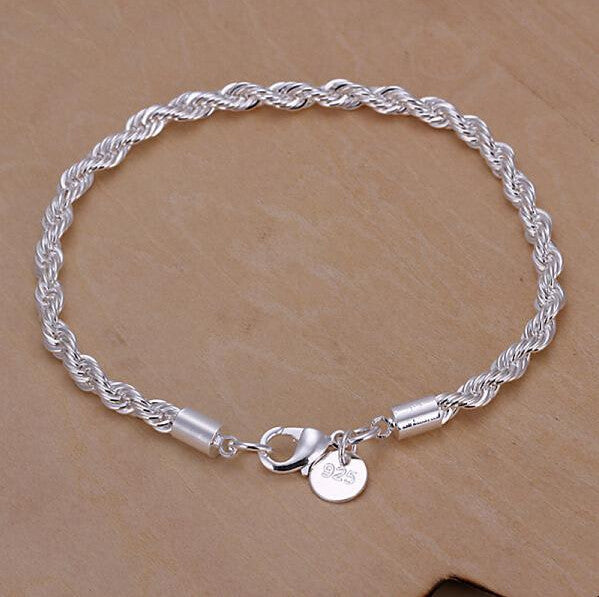 A bright silver spiral chain bracelet.