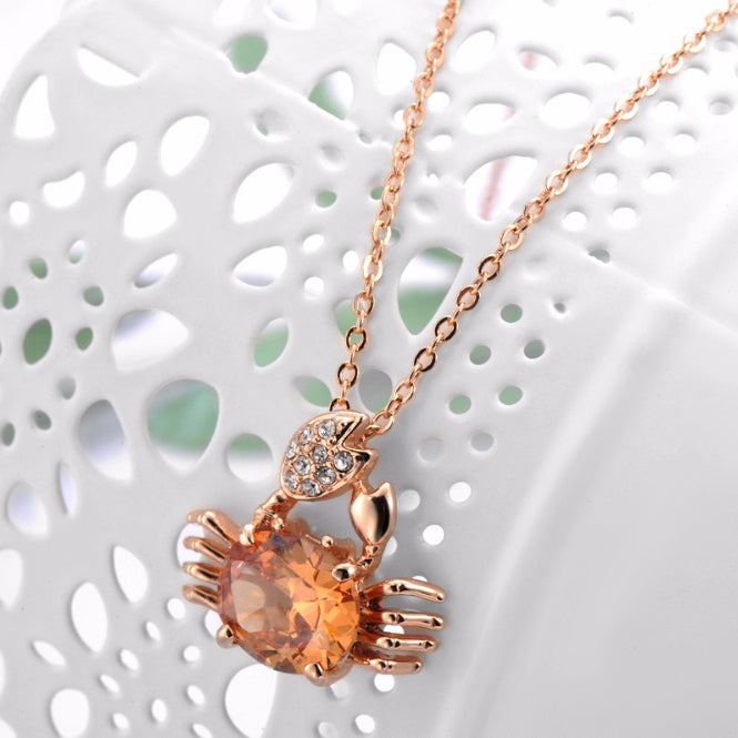 The Scylla Necklace - A tiny, adorable, citrine-coloured crab necklace.
