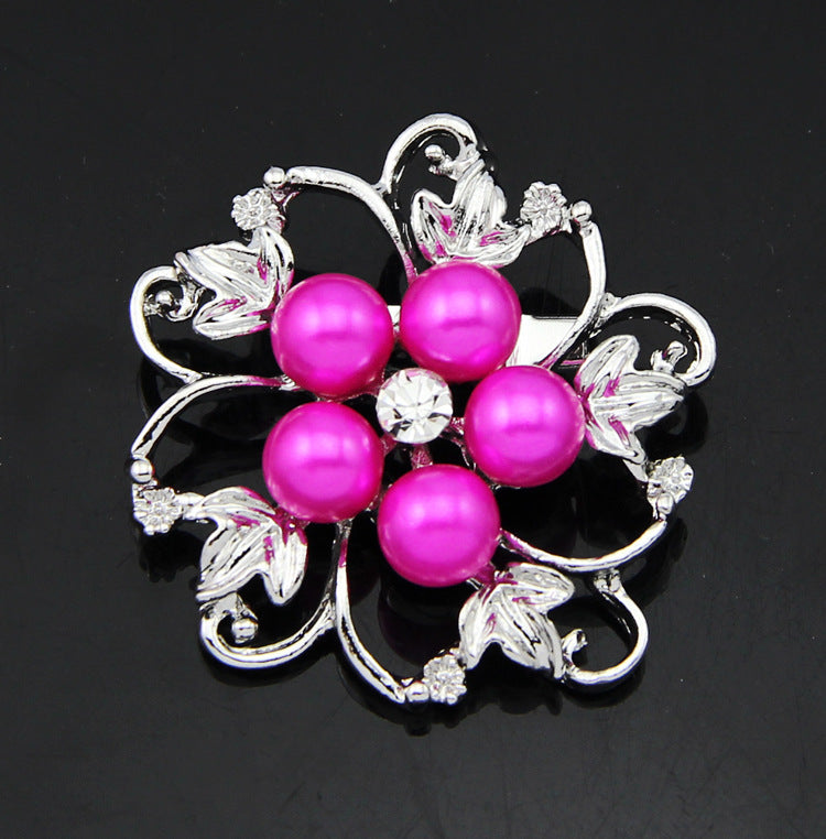 The Blossom Brooch - A large brooch with pink pearls.