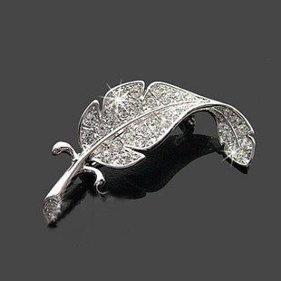 The Angel's Feather Brooch - A small silver brooch with crystals.