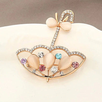 Abstract Brooch - Parasol - An adorable umbrella brooch with opalescent stones and crystals.
