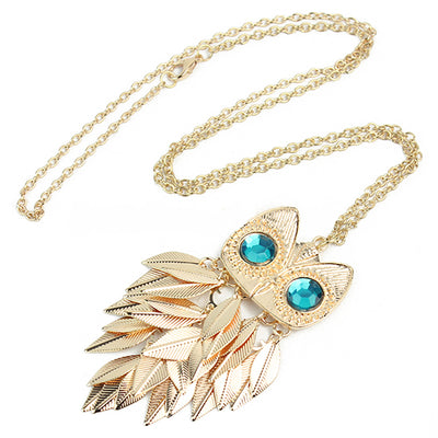 The Athena Sweater Chain - A long owl-themed gold coloured necklace.