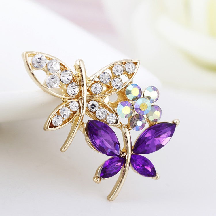 The Dual Butterflies Brooch - Available in purple or blue.