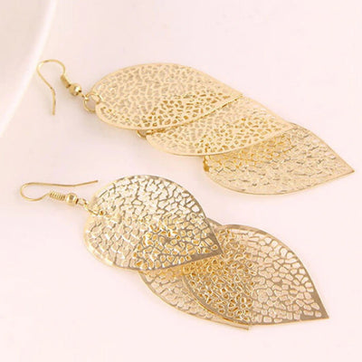 Large dangly leaf earrings available in gold or silver colours.
