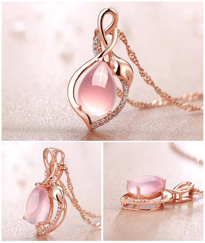 The Kore Necklace - A lovely delicate pendant studded with crystals, available in pink, blue, green, or purple.