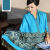 A lovely blue cotton shawl with a gold damask print.