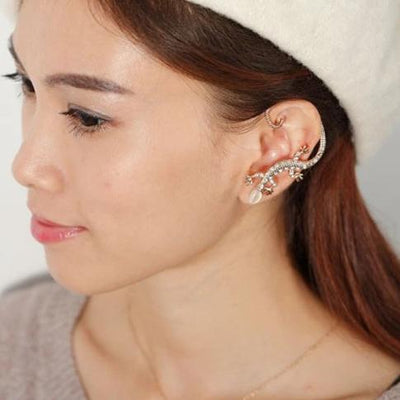 A cute lizard or gecko themed ear cuff, an earring that cuddles around the ear.