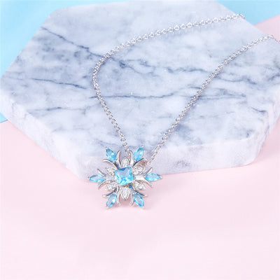 A beautiful snowflake pendant with blue topaz stones.