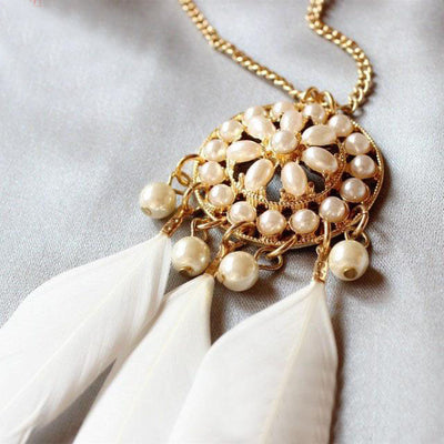 The Feathered Medallion - A long sweater chain adorned with feathers and faux pearls.
