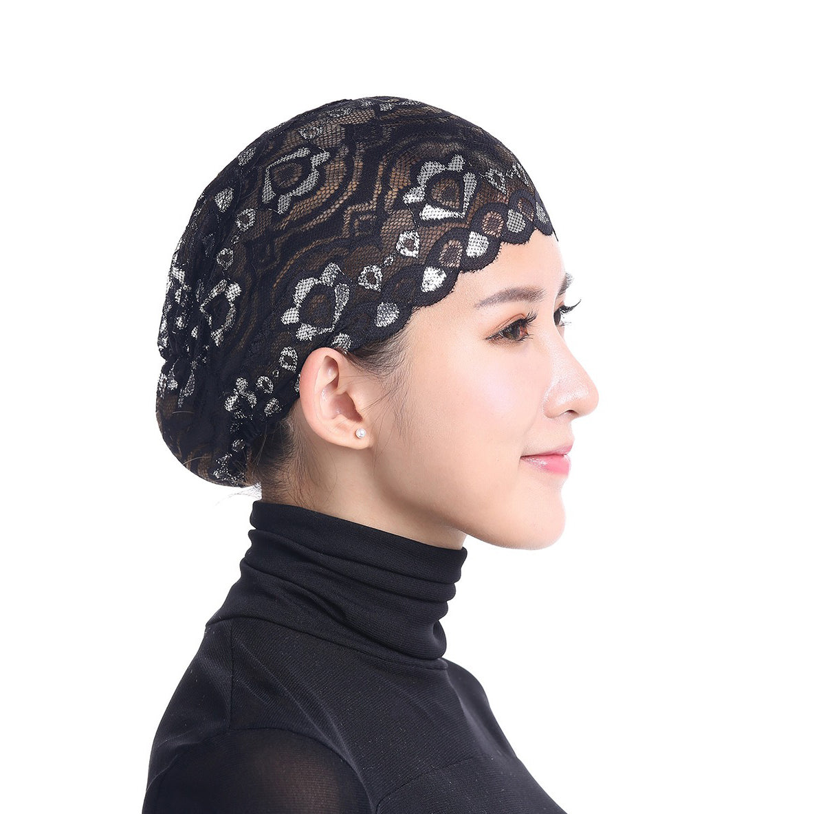 A black lace skull cap designed to be worn under a hijab scarf.