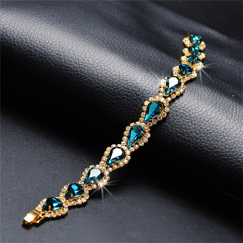 The Clarisse Bracelet - A lovely, luxurious crystal bracelet with topaz and zircon, set against gold coloured metal.