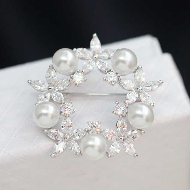 The Radiance Brooch - Wreath - A stunning crystal brooch shaped like a circle of flowers.