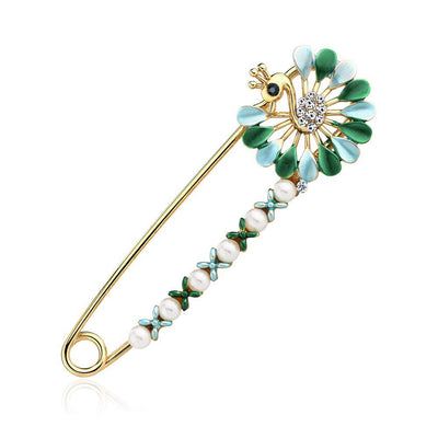 Scarf pins in assorted peacock designs, gold colour with zircon crystals and colourful enamel.