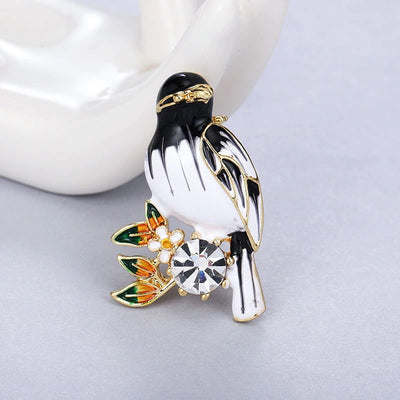 Cute Critters Brooch - Songbird - An adorable little bird perched on a sprig of flowers, adorned with brightly-coloured enamel and crystals. Available in green, blue, or black and white.