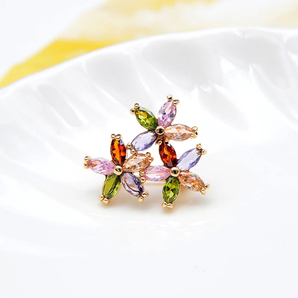 Bijoux Petite Posy Brooch - A tiny delicate brooch made of multi-coloured marquise-cut stones arranged to look like itty-bitty flowers.