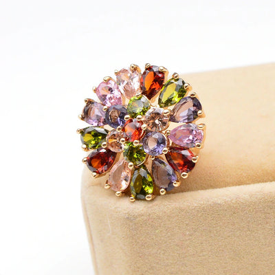 Bijoux Explosion I Brooch - A small but radiant circular brooch made of multi-coloured crystals in a burst of colour.